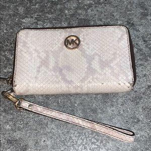 A snake skin Micheal Kors wallet
